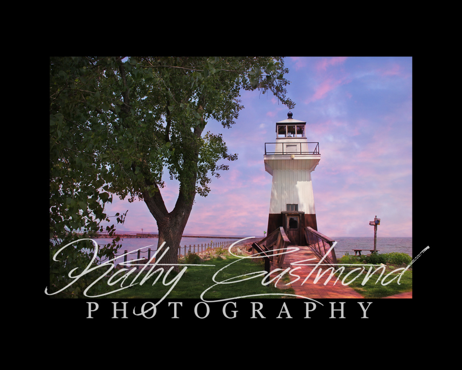 """Sunset Lighthouse"" 5x7 print mounted on a black 8x10 acid-free matte for $20 with free shipping within the U.S.  (Kathy Eastmond's signature will replace the copyright logo)"